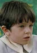 Freddie Highmore as young Peter Llewelyn-Davies