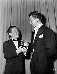 Bobby Driscoll receiving his Academy Award from Donald O'Connor in 1950