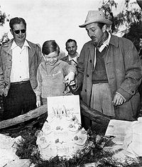 Bobby Driscoll celebrating his 9th birthday on the set of Song of the South on March 4, 1946, accompanied by Walt Disney (at the right), and director Harve Foster